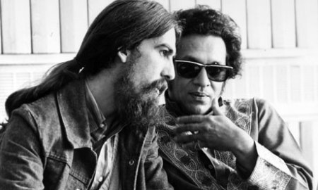 With George Harrison. Gotta love those sunglasses.