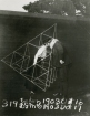 Alexander Graham Bell and Mabel kissing within a tetrahedral kite. From Nat Geo Found.
